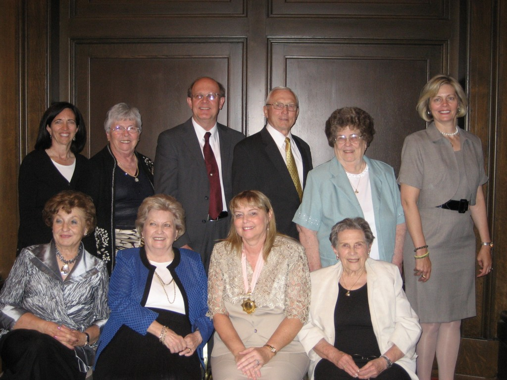 Governor Swan with board members of the Utah Mayflower Society. Front row Left to Right: Marion Harrison (Treasurer), Elaine Holbrook (Governor), Judith Swan (Governor General), Fern Nichols (Secretary); Back row L to R: Janis Rowser (Junior Chairperson), Prisicilla Haines (Historian), Kirk Hagen (Deputy Governor General), James Smedley (Councilor), Lois Oakes (Editor), Stephanie Weaver (Captain).